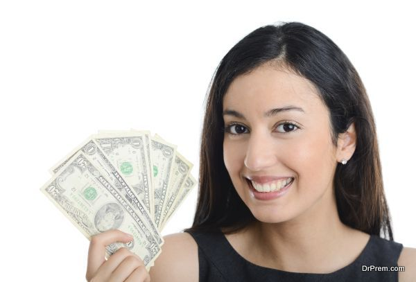 isolated portrait of beautiful and successful young business woman holding dollar bills