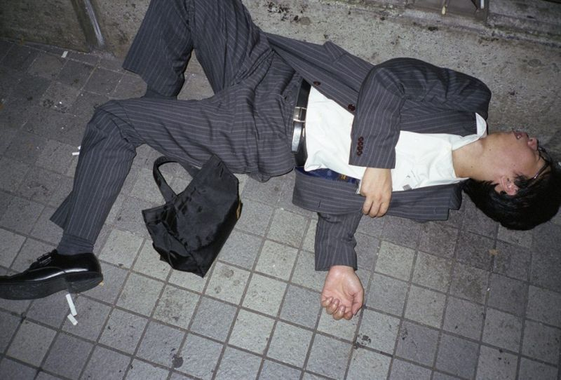 lying exhausted on the street