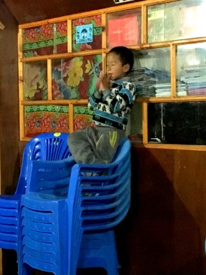 This kid was so full of spunk!! He was fake meditating on a pile of chairs to entertain us.