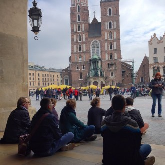 Drifters stopping to rest at Kraków's main square