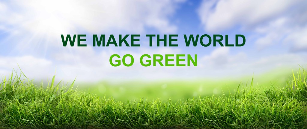 Wiese mit Slogan WE MAKE THE WOLRD GO GREEN