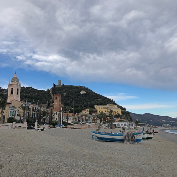 Noli, the village seen from the beach with the castle in the distance