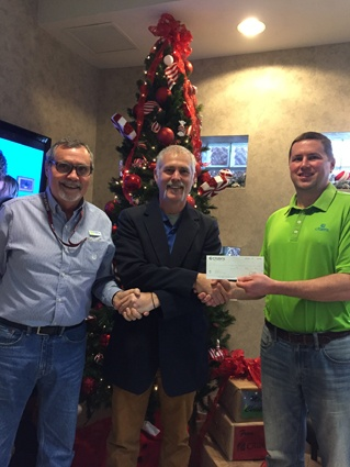 Jamie Reygle receives $250 from Billy Motley and Chris Bond at Citizens