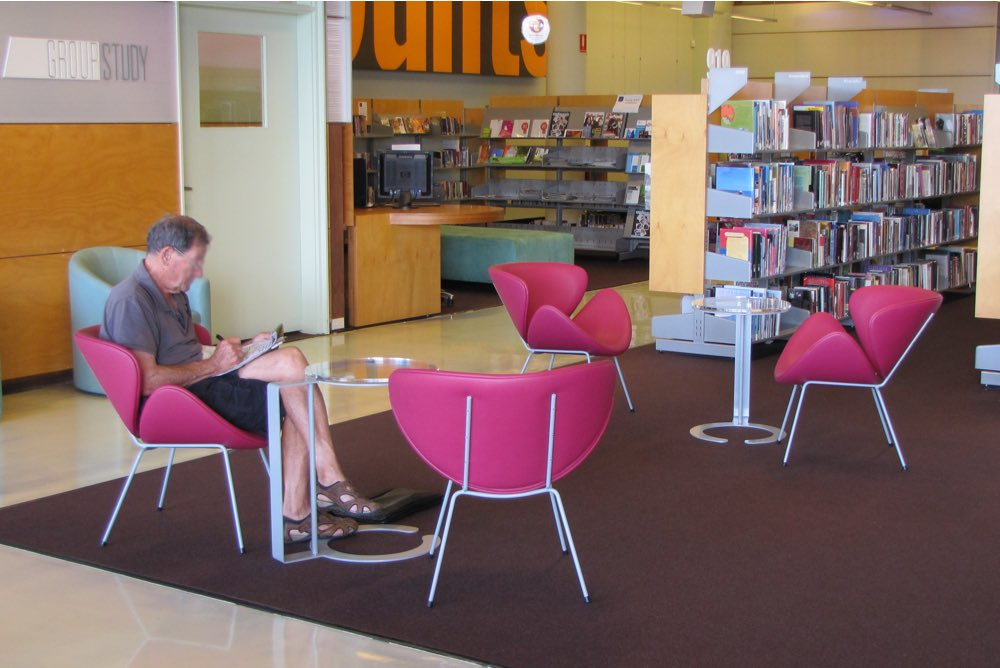 ANNA D Chairs scattered throughout a reading zone.