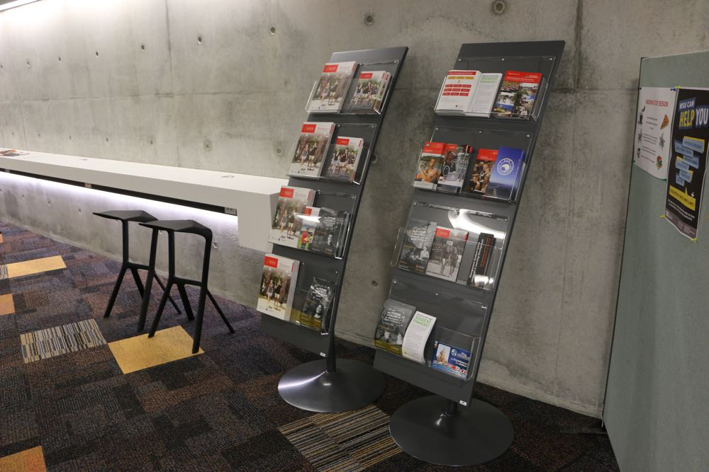 WOW BROCHURE Display Stands at The University of Waikato's Law and Management Building.