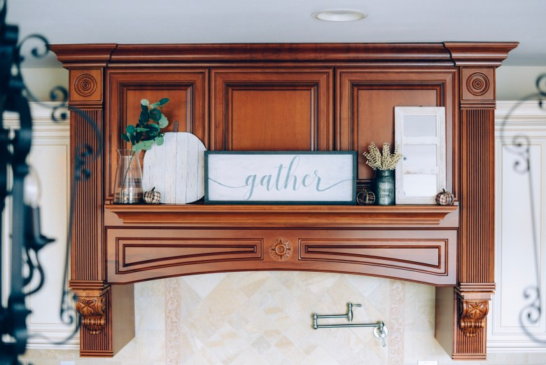 How I Decorated My Home Interior for Fall- stove hood with gather sign