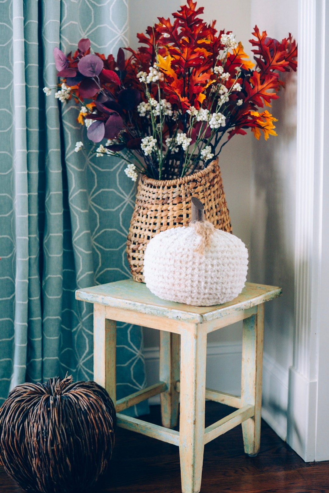 How I Decorated My Home Interior for Fall- target basket and faux fall foliage on a distressed stool