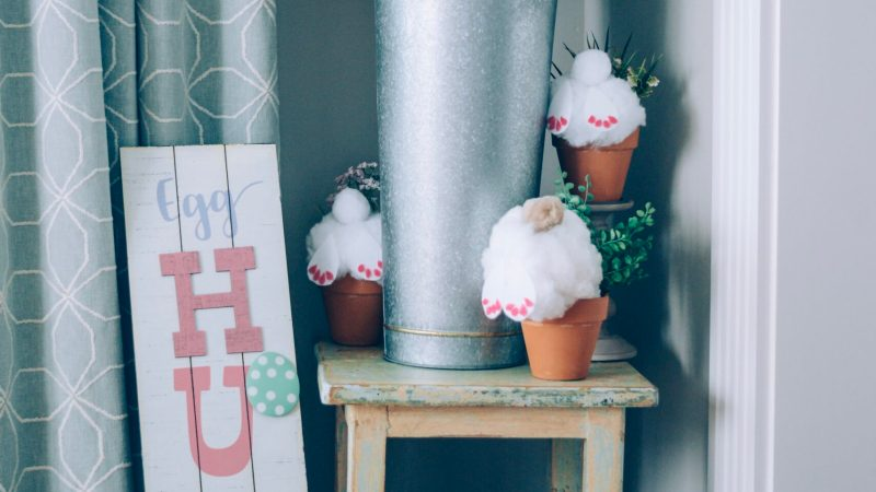 The Cutest DIY Spring:Easter Home Decor Idea- bunnies digging in a pot craft with pom poms