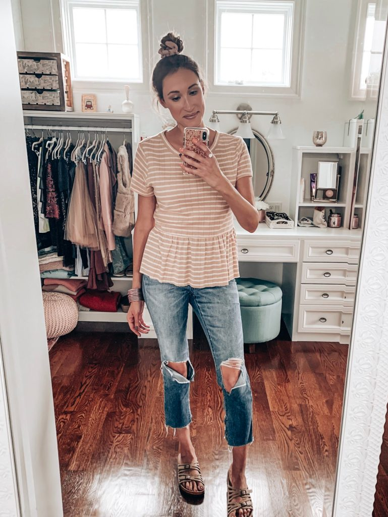 Cute casual fall outfit with a peplum top and ripped jeans.