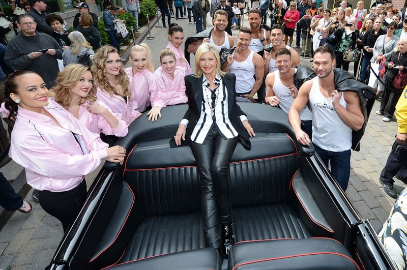 Olivia arrives at the Flamingo Hotel in Las Vegas for her 3 year residency flanked by Vegas showgirls & the Chippendales