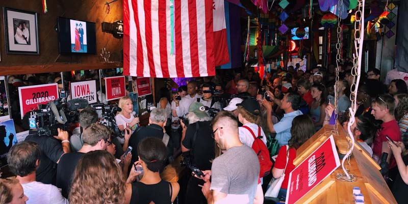Sen. Kirsten Gillibrand serves drinks at Des Moines gay bar (image via campaign)