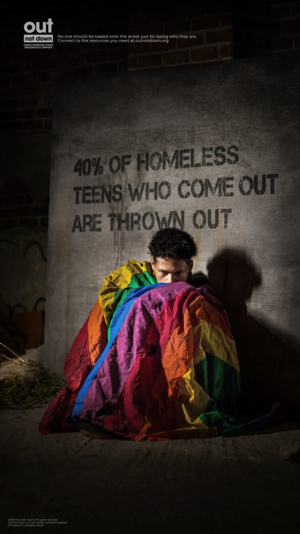 A homeless LGBTQ teen wrapped in a tattered Pride flag to highlight the struggles of discarded gay youth