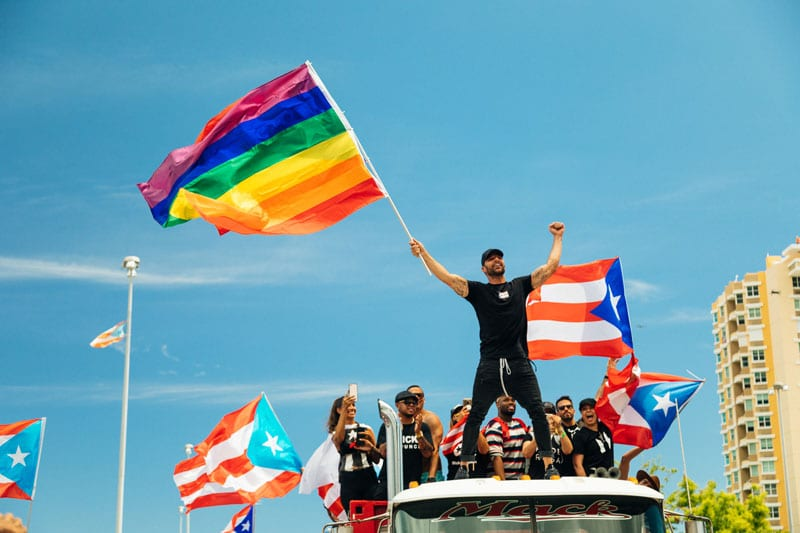 Ricky Martin waves a Pride flag during protests in San Juan, Puerto Rico (photo: Alejandro Pedrosa @WorldJunkies)