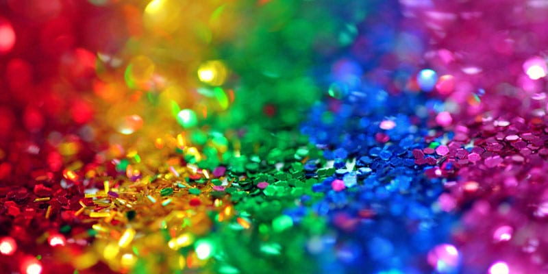 A photo of rainbow colored glitter