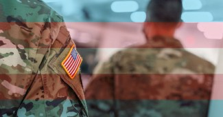 Transgender flag overlaying military soldiers uniform
