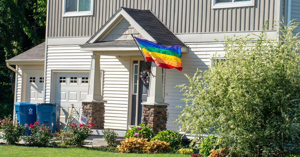 House flies the LGBTQ Pride flag