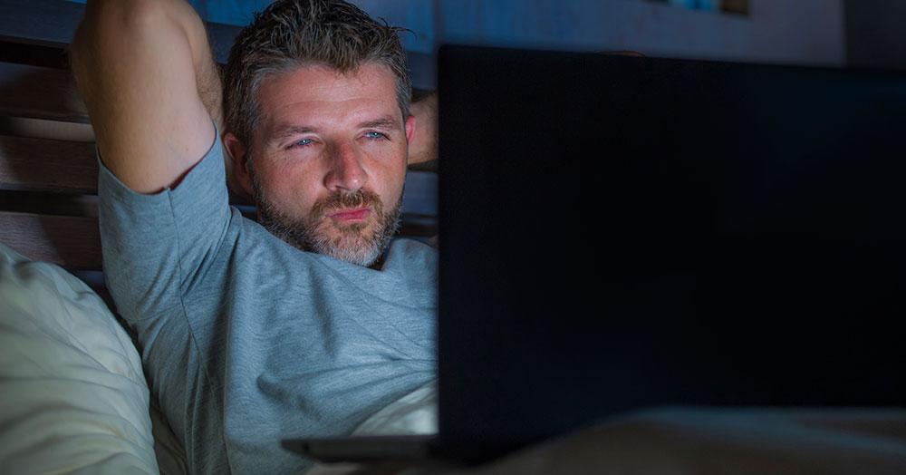 Man watching porn on laptop