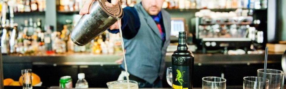 Bar tender pouring a cocktail