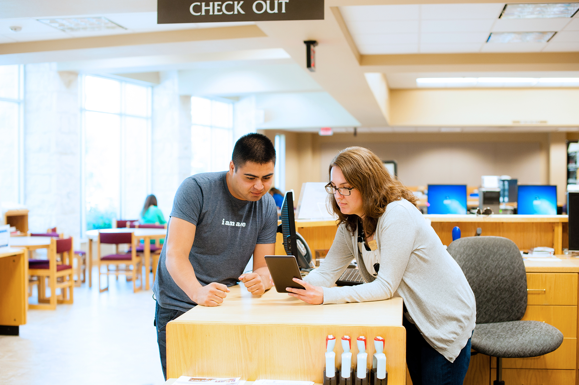 A librarian helping a student