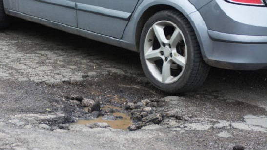 potholes and poor road maintenance causing accidents