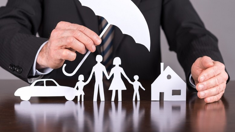 Insurance Pic Man with Umbrella and Family