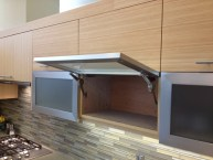 A little funky for some people, the lift up upper cabinet doors work great.