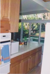 Left side is the Easy Bake oven that burned all food. On the right is the refrigerator sticking out in the original kitchen.