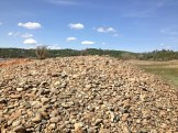 Piles of river rock left from dredging or hydraulic mining.