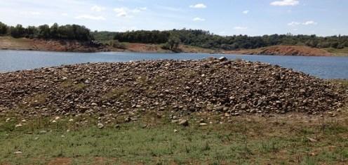 Piles of washed river rock rest even above Folsom Lake at Rattlesnake Bar.