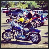 Lots of motorcycles carried fans to the boat races.