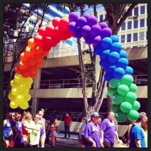Floating Rainbow Balloon Arch.