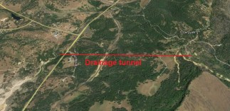 Approximate location of Spring Valley Mining drainage tunnel into Sawmill Ravine.