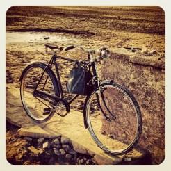 Retro vintage bike exploring normally submerged house foundation at Folsom lake