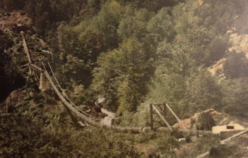 45 inch water pipe for hydraulic mining supported by suspension bridge in Trinity County.