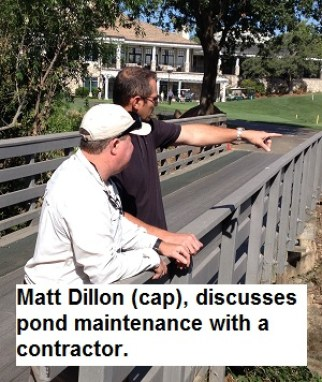 Matt Dillon discuss weed control in the Linda Creek pond with a contractor.