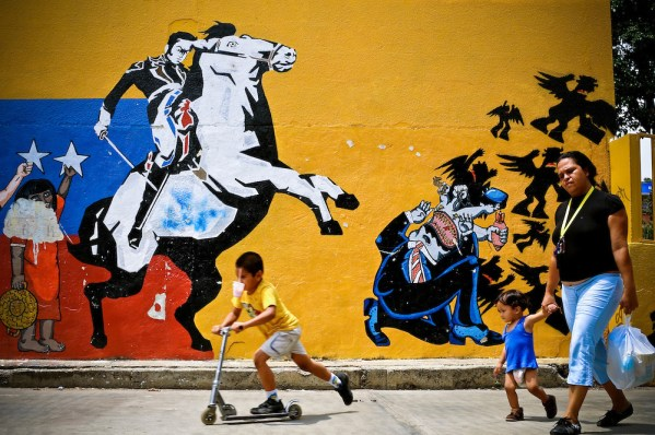 A mural painted by Carlos Zerpa, 26, of the Guerrilla Communications Collective in Catia, a slum in Caracas, Venezuela. The mural depicts a heroic Simon Bolivar defeating corrupt big business.