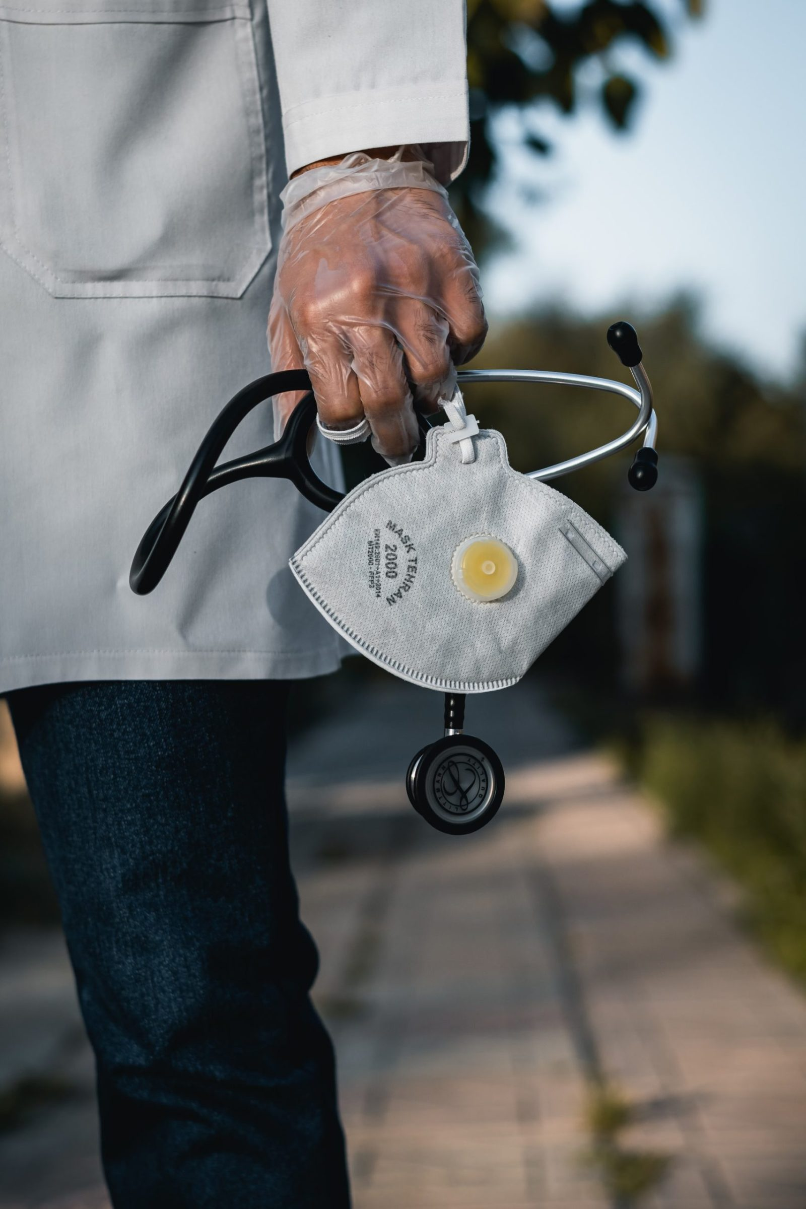 A doctor holding an N95 mask. N95 masks are typically disposable and not meant to be washed or reused. Washing a disposable N95 mask will likely compromise its integrity..