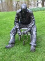 Statue of man in clogs at the Keukenhof