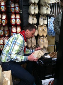 A wooden shoemaker in action