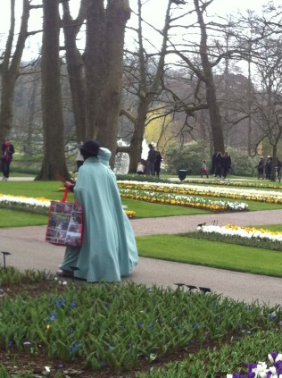 Japanese tourist in billowing cloaks and sunhats. Are they Japanese nuns?