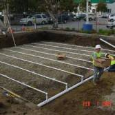 Drainfield installation in parking area