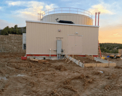200,000 gallon water storage tank and pump building
