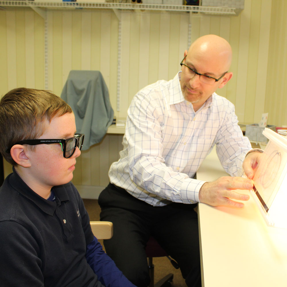 Patient does Vision Therapy exercise