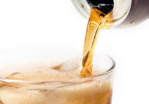 Closeup of a pouring soda on white background