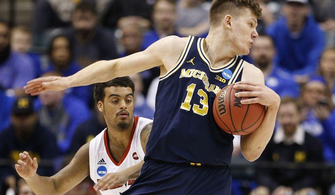 Michigan keeps NCAA tournament run going with upset of No. 2 Louisville