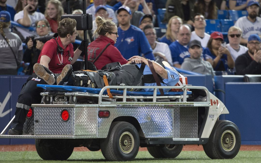 Umpire Dale Scott stretchered off field after being struck in mask by foul tip