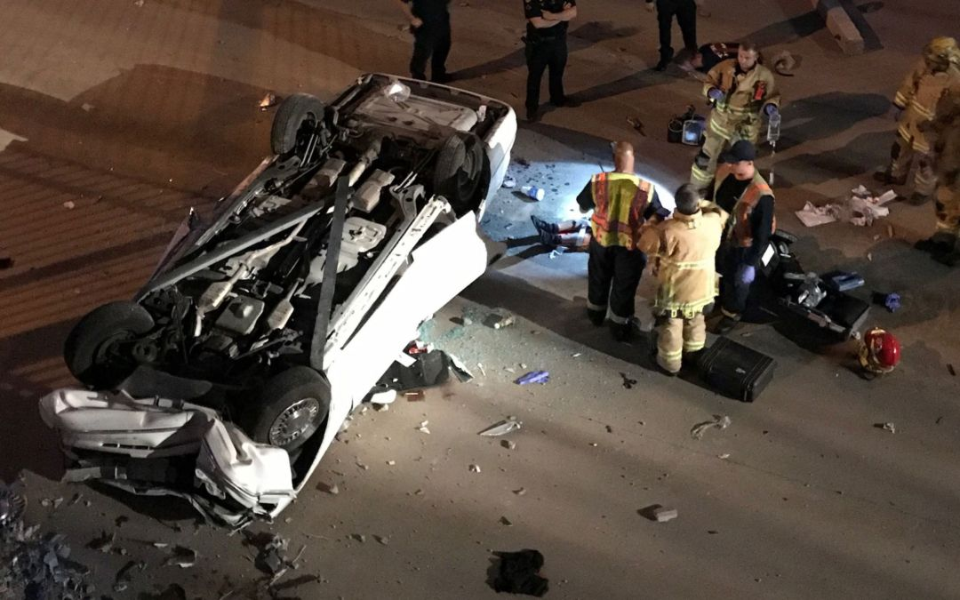 Person trapped after vehicle flips into Phoenix dry canal