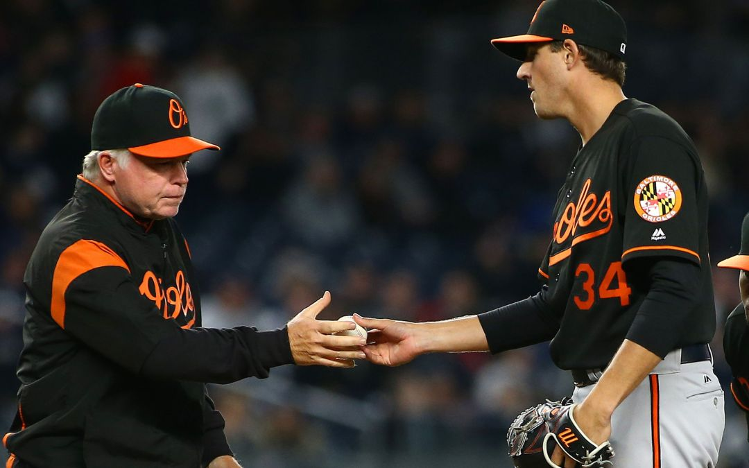 Orioles manager Buck Showalter tries to change pitchers during HR trot