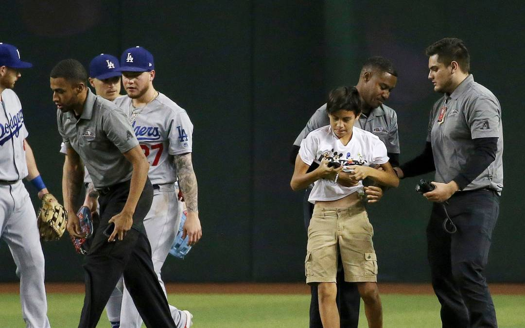 MLB fans running onto field at Dodgers games prompting safety concerns