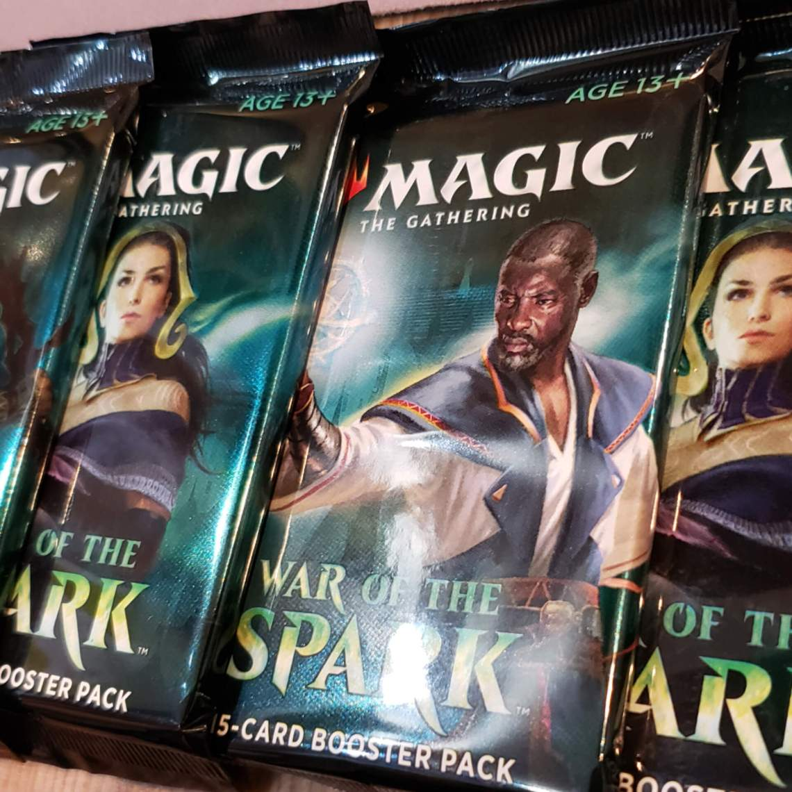 A spread of booster packs for the War of the Spark expansion.